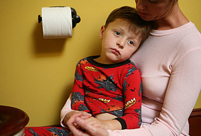 webmd_photo_of_sick_child_near_toilet